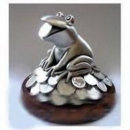 Скульптура денежной лягушка