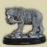 Статуэтка из серебра медведь