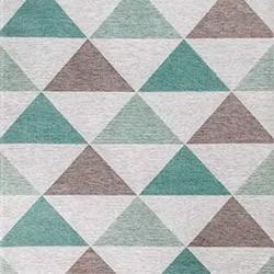 Тканый ковер с геометрическими узорами преображает интерьер наполняя его уютом.