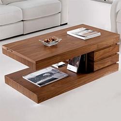 Деревянный журнальный столик. Дерево не выделяет токсичных паров в отличии от ДСП и прослужит дольше.