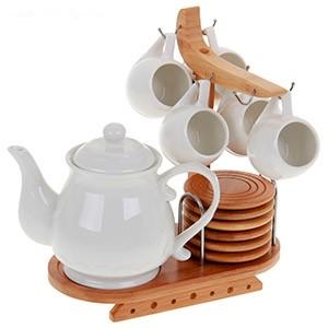 Чайник с кружками на красивой подставке